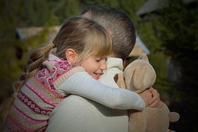 hugging dad goodbye